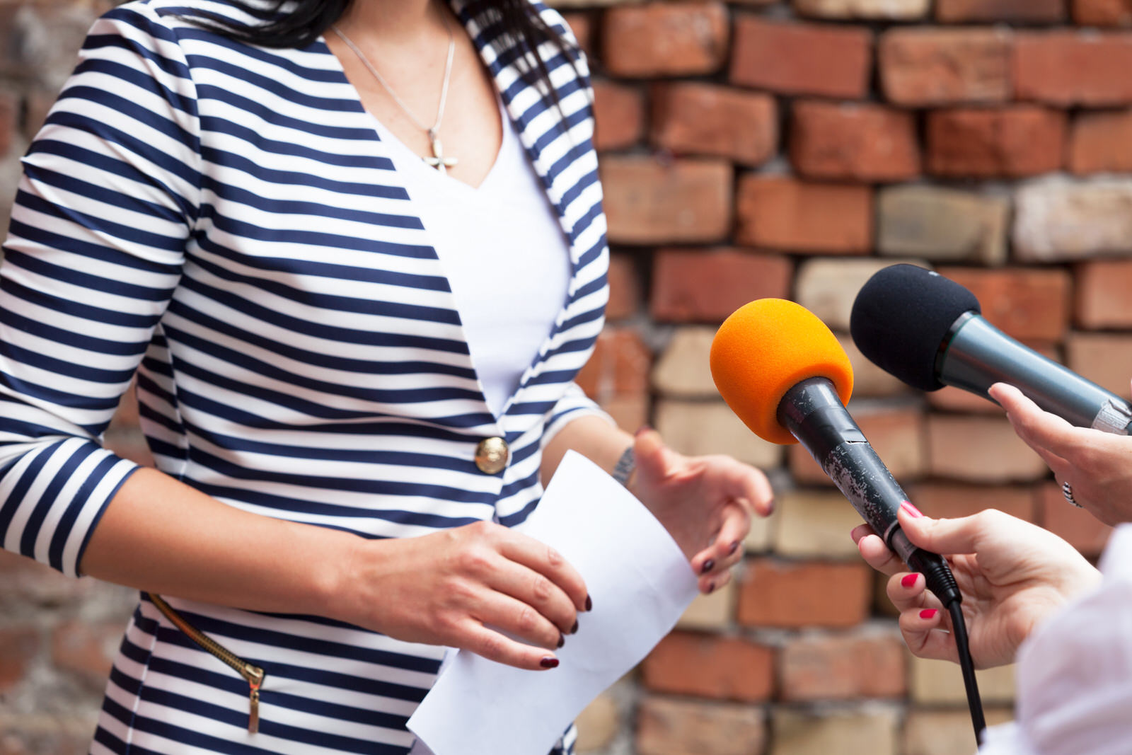 Woman at press conference